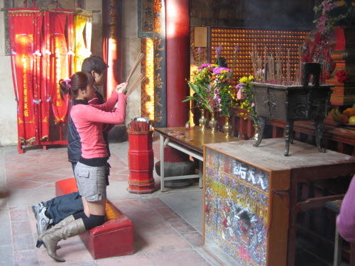 Young couple praying in Great Queen of Heaven Temple, Tainan